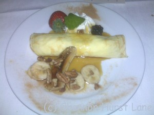 Bananas Foster Crepe served w/ Community Coffee or Port